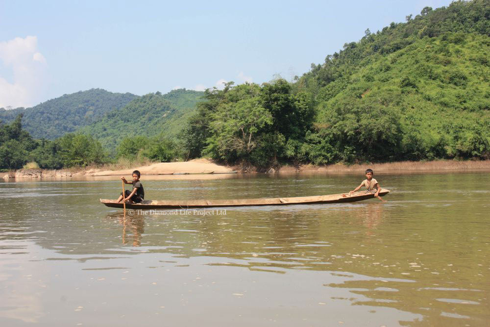 Children in a boat along the Mekong River, Laos