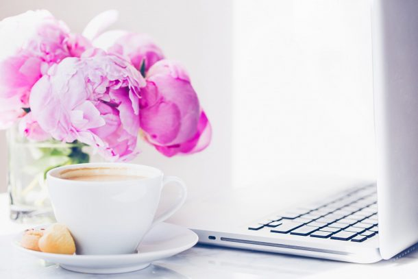 Newsletter signup with peony and laptop