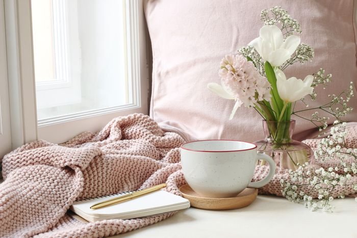 blanket and tea in cosy space