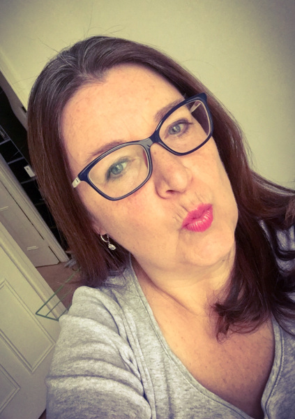lady kissing wearing glasses